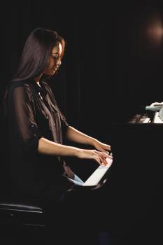 Female student playing piano #413543