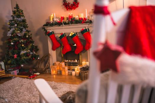 Christmas tree with presents near the fireplace Free Photo