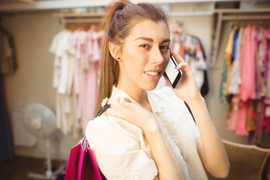 Woman talking on mobile phone while shopping #413630