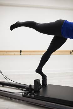 Woman exercising on reformer #413680