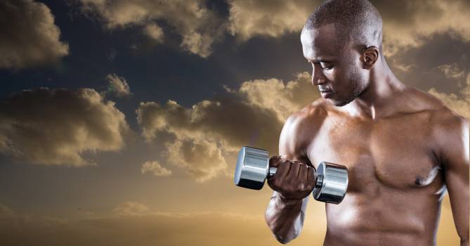Athlete doing workout with dumbbell against sky background #413681