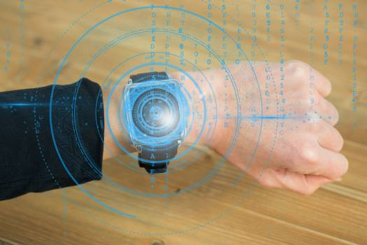 hand using smartwatch with graphics #413716