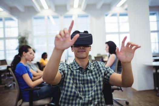 Man using virtual reality headset Free Photo