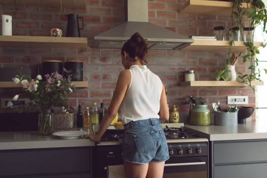 Woman preparing food in kitchen at comfortable home Free Photo