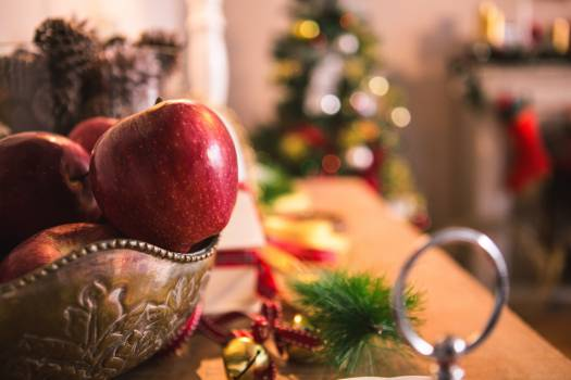 Fruit bowl and christmas decoration on wooden table #413771