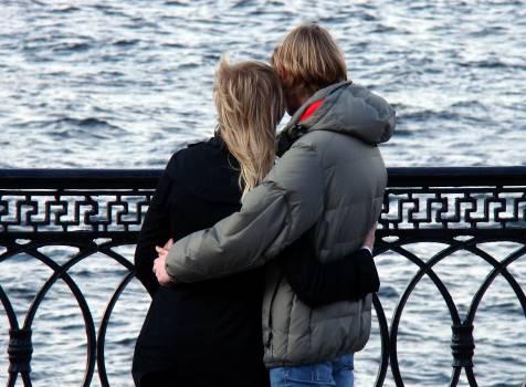 Man in Grey Bubble Jacket Beside Woman in Black Sweater #41379