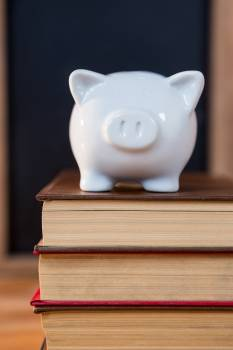 Close-up of books stack with a piggy bank #413806