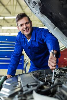 Mechanic servicing a car engine #413817