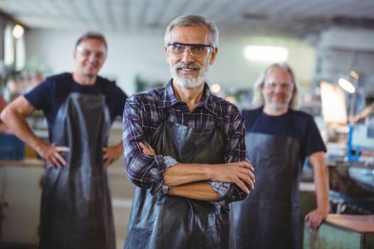 Portrait of smiling glassblowers Free Photo