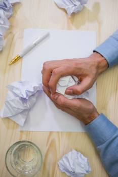 Hands of business executive making paper ball #413862