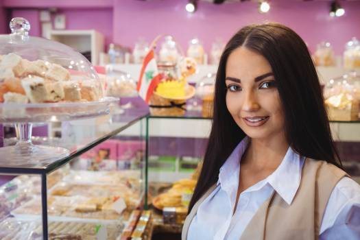 Beautiful woman standing in a turkish sweets shop #413895