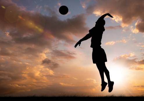 Silhouette of player hitting a ball #413914