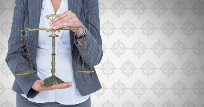 Judge with balance scale in front of wallpaper #413951