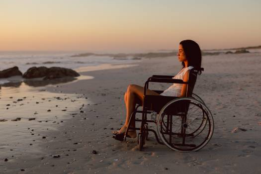 Disabled woman in wheelchair on the beach #413970
