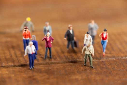 Miniature people travelling #413981