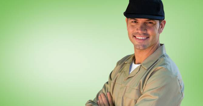 Portrait of smiling delivery man in cap #413988