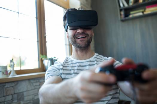 Happy man using virtual reality headset and playing video game #413989