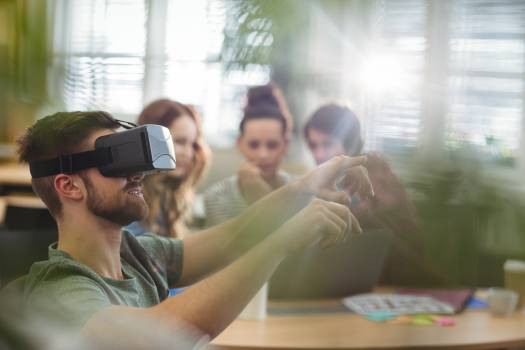 Male business executive using virtual reality headset #414001
