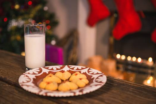 Christmas cookies on plate with a glass of milk #414042