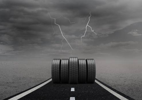 Tyres on road against overcast #414043