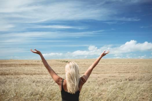 Rear view of blonde woman standing in field #414084