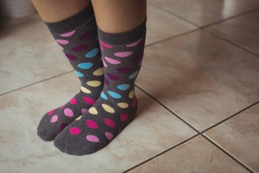 Womans feet wearing multicolored polka dots socks #414086