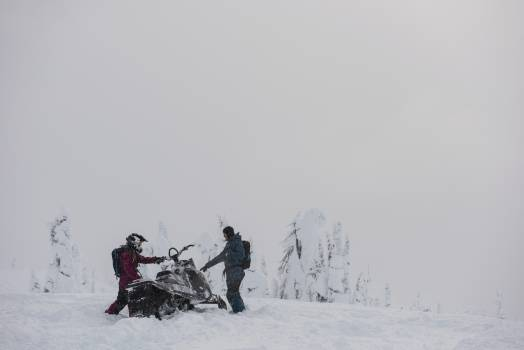 Couple ready to ride snowmobile in snowy alps #414155