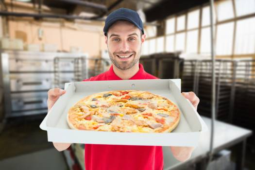 Composite image of smiling man with pizza #414189