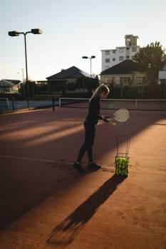 Tennis player practicing tennis in ground #414198