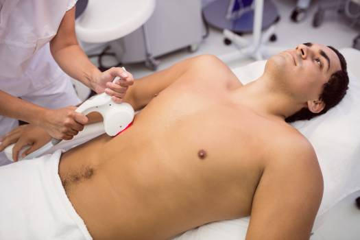 Man receiving laser hair removal treatment #414208