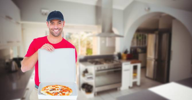 Delivery man showing pizza in box #414233