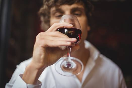 Man having a glass of red wine #414234
