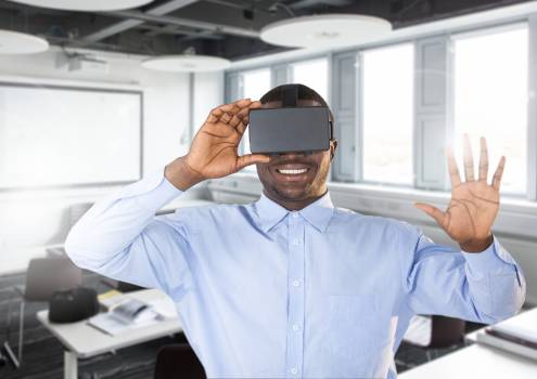 Man using virtual reality headset in office #414240