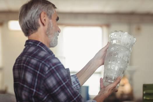 Glassblower examining glassware #414266