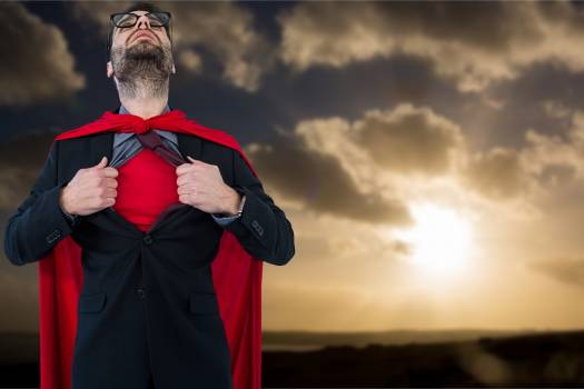 Businessman in super hero costume tearing shirt during sunset #414268