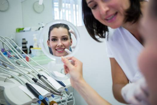 Patient looking at her face in mirror #414308