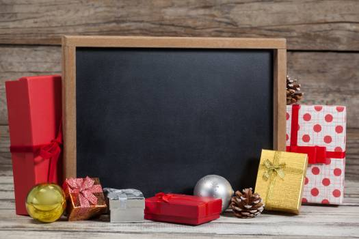 Christmas gifts and decoration arranged with blank board #414321