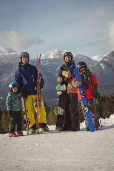 Family in skiwear standing together on snowy alps #414325