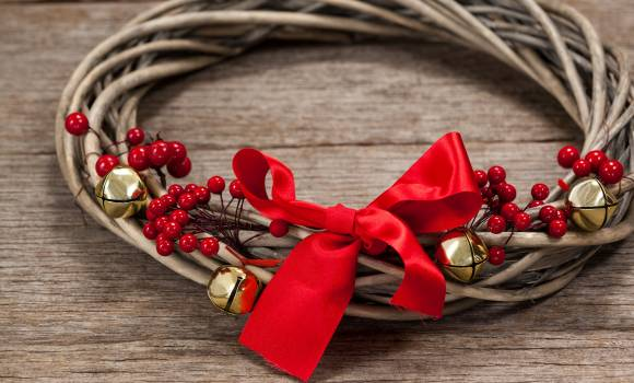 Close-up of grapevine wreath with red ribbon #414338