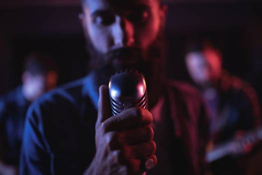 Man singing on retro microphone #414348