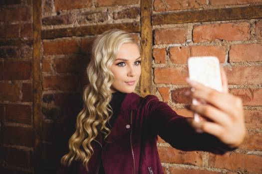 Beautiful woman taking a selfie on her mobile phone #414363