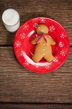 Ginger bread and milk on wooden table #414370