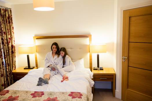 Mother and daughter using digital tablet in bedroom #414373