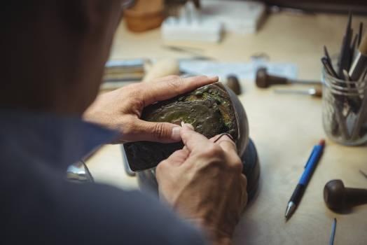 Craftswoman working in workshop #414376