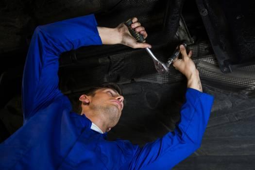 Mechanic servicing a car #414389