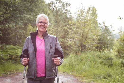 Senior woman hiker walking in the forest #414391
