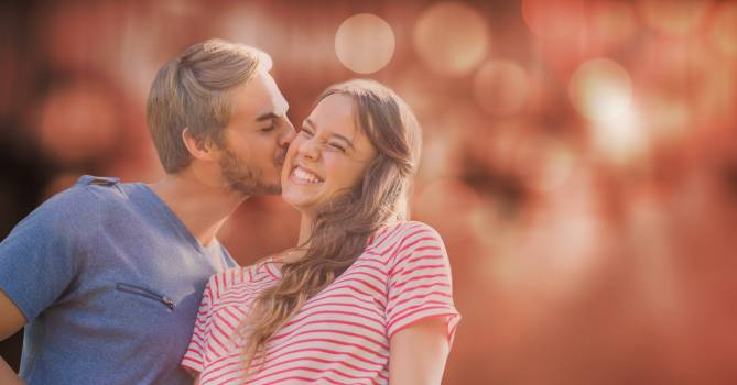 Man kissing woman over blur background #414430