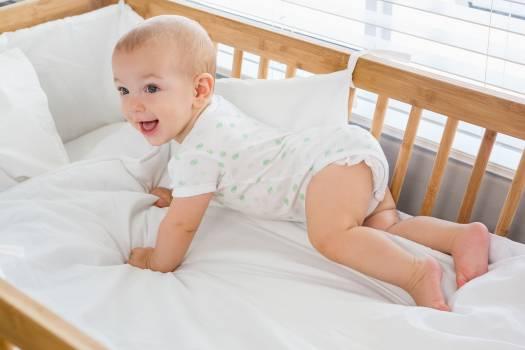 Cute baby boy on a cradle #414434
