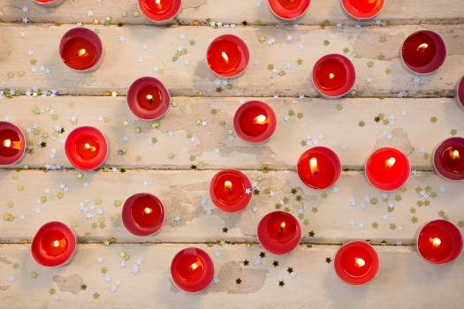 Candles burning on wooden plank #414436