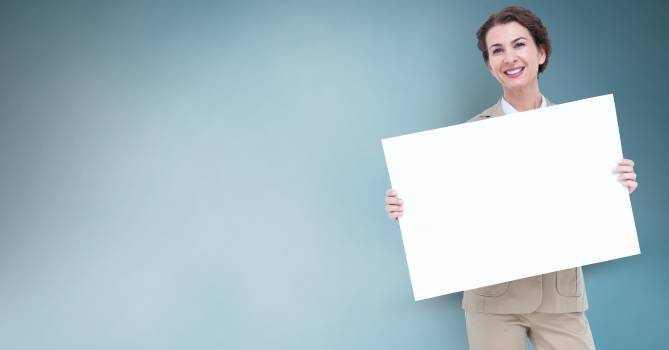 Businesswoman holding blank billboard Free Photo